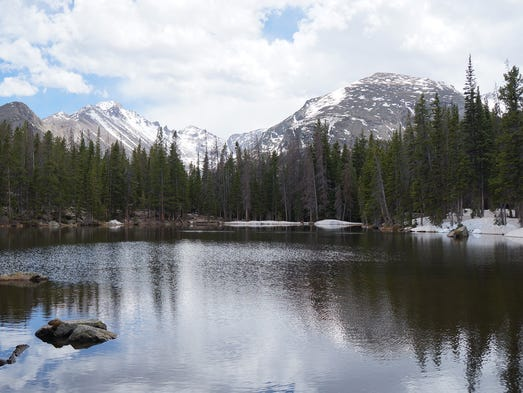 Rocky Mountain National Park has protected land in the Rocky Mountains around Longs Peak for 100 years now.