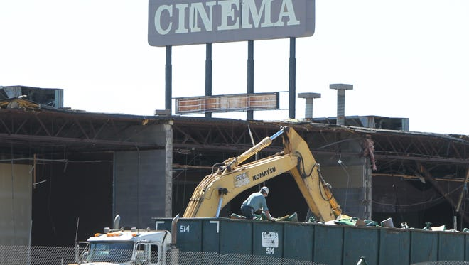 A truck driver sorts through debris from the September 2015 demolition of Showcase Cinema in Erlanger before leaving the site.