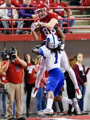 University of South Dakota wide receiver Brandt Van Roekel (88) catches a touchdown pass over the head of Indiana State cornerback Rondell Green (1) during the first half of their NCAA football game on Saturday, Oct. 14, 2017 at the DakotaDome in Vermillion, S.D.