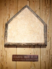 The original home plate from the original Scottsdale Stadium hung on the wall at the Pink Pony.