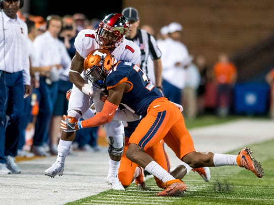 Illinois defensive back Cameron Watkins (31) knocks Western Kentucky wide receiver Nacarius Fant (1) out of bounds during the second quarter of an NCAA college football game Saturday, Sept. 9, 2017, in Champaign, Ill. Watkins was called for a late hit on the play. (AP Photo/Bradley Leeb)