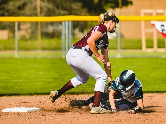 Aubrie Benward, left, tags out a base runner during