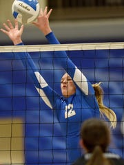 West Central's Ashlyn MacDonald blocks against Sioux