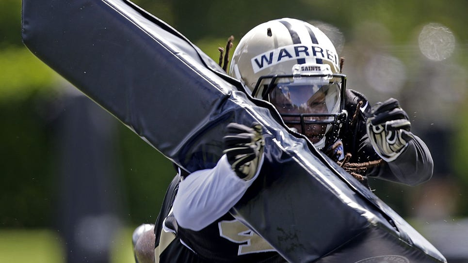New Orleans Saints safety Pierre Warren hits a pylon