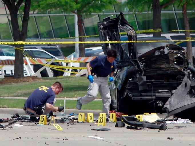 FBI investigators work a crime scene outside of the