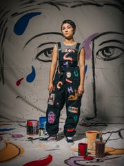 Sofia Enriquez wearing her own hand-painted shirt, overalls and shoes. Styling by Patrick Michael Lopaze