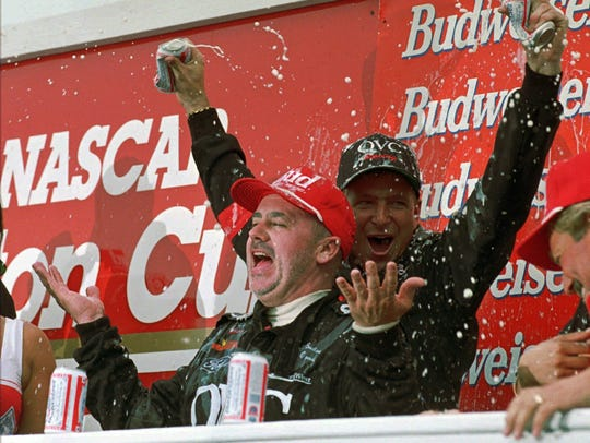 Geoff Bodine celebrates with a crew member after winning