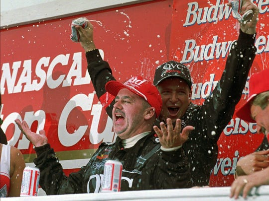 Geoff Bodine celebrates with a crew member after winning the Bud at The Glen in 1996.