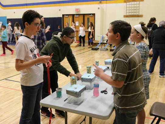 Two student volunteers run a game at the Whitnall Middle