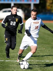 Ithaca's Michael Gualtieri looks to pass the ball as
