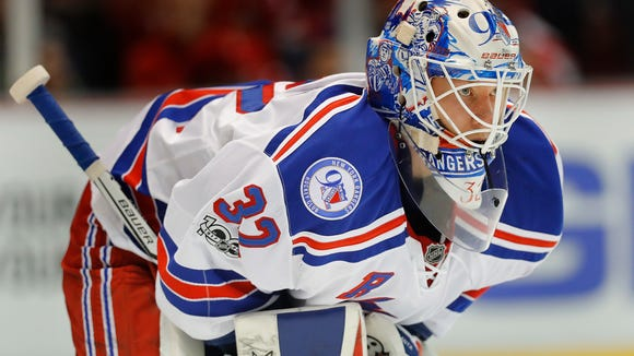 New York Rangers goalie Antti Raanta (32) plays against the Detroit Red Wings in the second period of an NHL hockey game Sunday, March 12, 2017, in Detroit. (AP Photo/Paul Sancya)