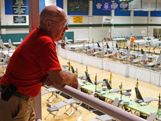 Dr. Weston Heringer, Jr., looks down on a giant dental clinic volunteers set up in the gymnasium at Chemeketa Community College on Thursday, July 10, 2014. The clinic could serve as many as 1,500 low-income residents on Friday and Saturday.