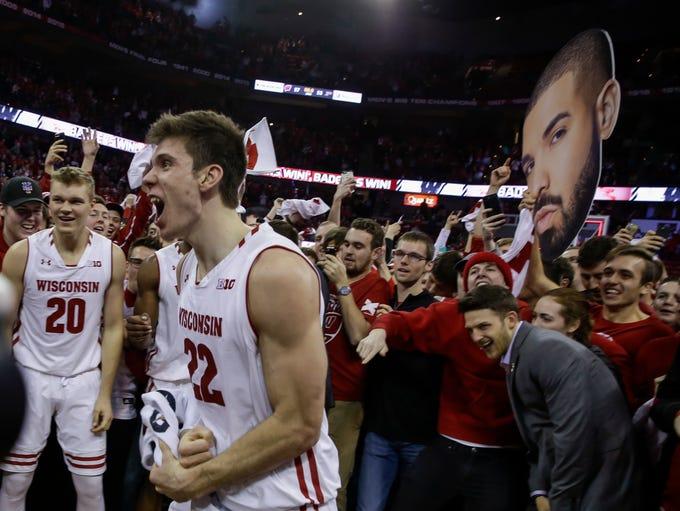 Wisconsin's Ethan Happ (22) celebrates with teammates