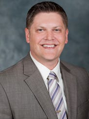 Jay Gerlach is associate professor of political science
