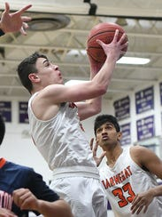 Barnegat's Mike Revello goes up for his 1000th career