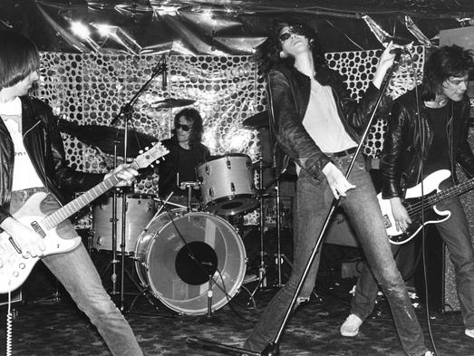 Johnny, Tommy, Joey and Dee Dee of the Ramones jam in a scene from the motion picture 'End of the Century.'