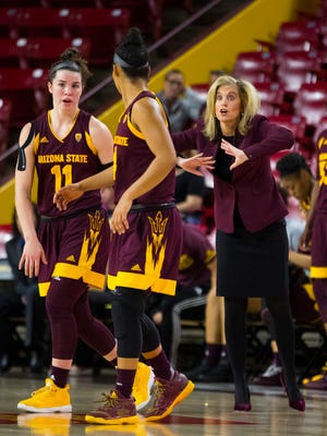 ASU's head coach Charli Turner Thorne instructs her players Robbi Ryan (L) and Kiara Russell during the first half at Wells Fargo Arena on February 4, 2018 in Tempe, Ariz.