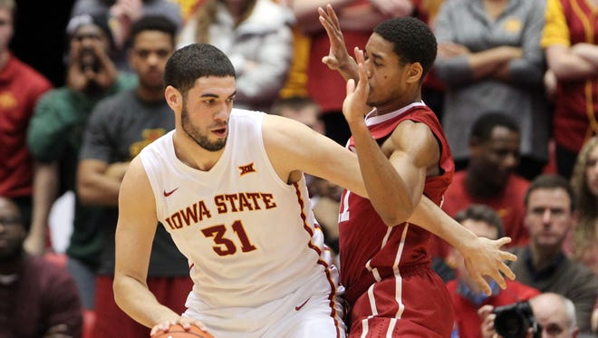 Oklahoma Sooners guard Isaiah Cousins (11) defends Iowa State Cyclones forward Georges Niang (31) at James H. Hilton Coliseum. Iowa State beat Oklahoma 77-70.
