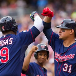 Aug 21, 2014; Minneapolis, MN, USA; Minnesota Twins right fielder Oswaldo Arcia (31) congratulates designated hitter Kennys Vargas (19) after his home run in the fourth inning against the Cleveland Indians at Target Field. The Minnesota Twins win 4-1. Mandatory Credit: Brad Rempel-USA TODAY Sports
