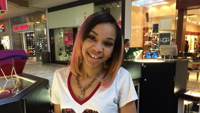 Brooke Murray, 20, fled her kiosk in Castleton Square Saturday night, Jan. 3, 2015, after hearing a gunshot that prompted a stampede of mall patrons. She found refuge with others in a nearby store.
