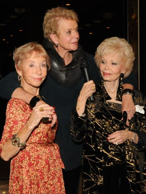 Event co-chair Mary Ellen Blanton, hostess Donna MacMillan and event co-chair Rev. Patty Spicer.