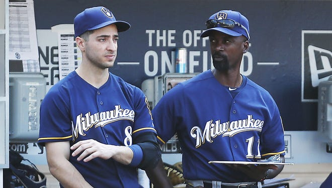 Brewers hitting coach Darnell Coles (right) with Ryan Braun in the dugout.