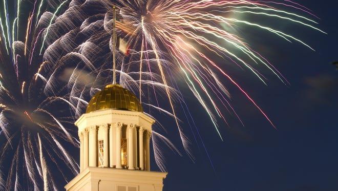 Fireworks ignite behind the Pentacrest on Wednesday, July 4, 2012.