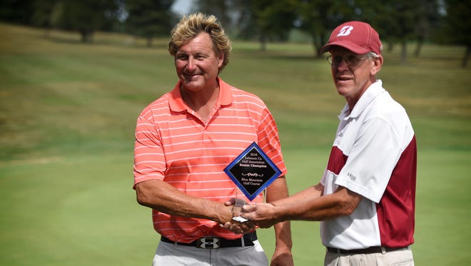 Tom Kintzer, left, won the 2016 Lebanon County Senior Amateur Golf Tournament on Friday at Blue Mountain. Tournament director Skip Krick presents Kintzer with his trophy.