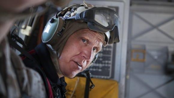 U.S. Sen. Thom Tillis, R-N.C., rides in a military aircraft during a June visit to military installations in eastern North Carolina. He serves on two committees with military-related responsibilities.