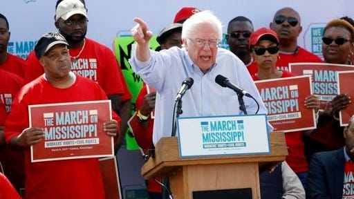 "U.S. Sen. Bernie Sanders, I-Vt, tells thousands at a pro-union rally near Nissan Motor Co.'s Canton, Miss., plant, Saturday, March 4, 2017, that he congratulates workers for their courage ""in standing up for justice."" Among the participants were actor Danny Glover, national NAACP President Cornell Brooks, U.S. Rep. Bennie Thompson, D-Miss., and UAW president Dennis Williams."