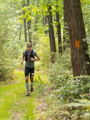 Chambersburg's Danny Mowers works his through the Eastern States 100 in the Pennsylvania Wilds on Aug. 12. Mowers, 39, claimed fourth place with a time of 24:40:19. With the finish, he became the winner of the PA Triple Crown, awarded to the top performer at the Hyner 50K, World's End 100K and Eastern States 100.