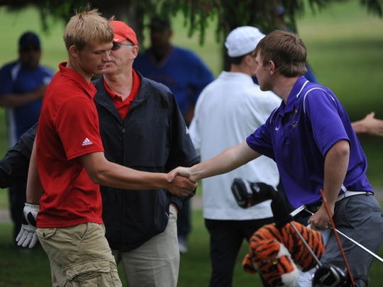 Union County's Tyler Osborne shakes hands with Hagerstown's Ben Tinkle after a sudden death playoff Saturday, May 21, 2016 at Winding Branch Golf Course in Pershing.