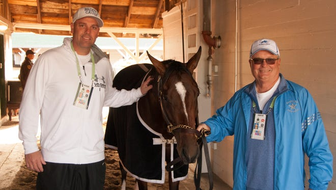 Brody's Cause co-owners Jason Loutsch and Dennis Albaugh with the Kentucky Derby contender on the backside at Churchill Downs the day before the big race.