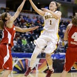 SDSU's Megan Waytashek takes a shot over USD's Nicole Seekamp in the first half of Monday's semifinal game of the Summit League conference tournament, March 10, 2014 in Sioux Falls, S.D. USD beat SDSU 72-58.  (Elisha Page / Argus Leader)