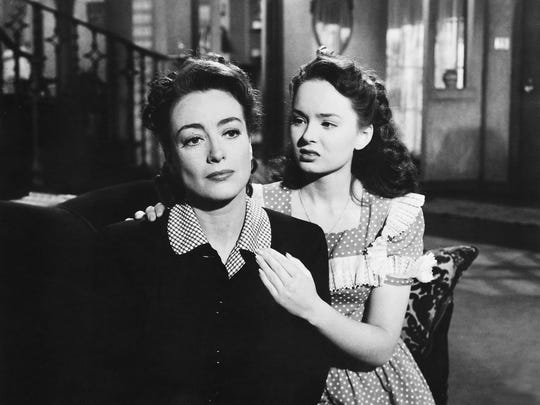 Joan Crawford, left, and Ann Blyth play mother and