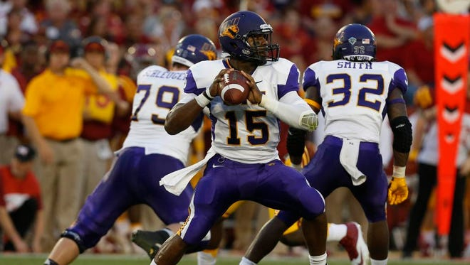 Northern Iowa quarterback Aaron Bailey looks downfield for a receiver in Saturday's loss at Iowa State. Bailey impressed with his feet in a start but threw a costly interception.
