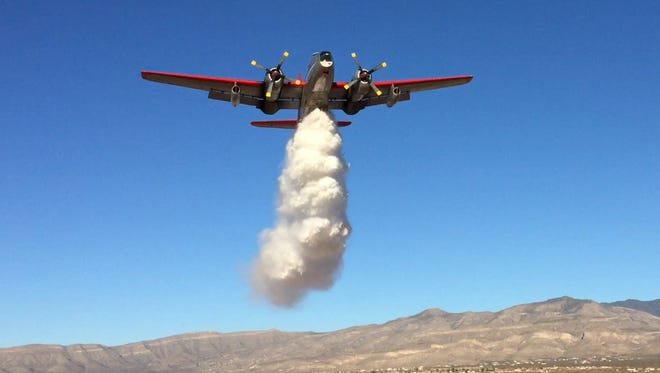 A P2V Neptune aircraft practices dropping water near Alamogordo in February. Neptune Aviation Services fights forest and wildfires nationally.