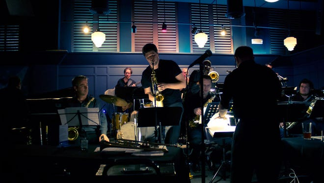 Scott Belck leads the Cincinnati Contemporary Jazz Ensemble with saxophonist Jeremy Long, soloist, at the now-closed Blue Wisp Jazz Club, Downtown.
