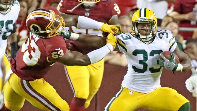 Green Bay Packers running back Aaron Jones (33) fights for yardage against Washington linebacker Zach Brown (53) on Aug. 19, 2017, at Fedex Field.