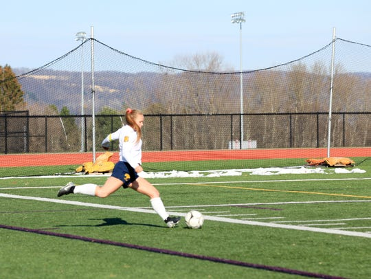 Luca Fahmer kicks the ball to her Spencerport teammates