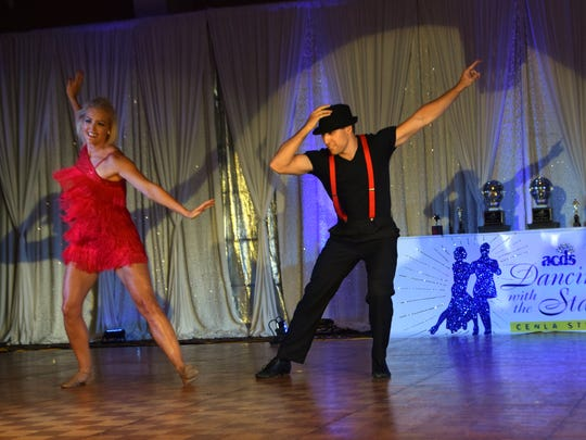 Kathryn Gassiott (left) and Lance Lopez perform at Dancing with the Stars Cenla Style.
