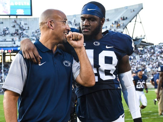 Penn State Nittany Lions head coach James Franklin talks with Penn State Nittany Lions defensive end Shareef Miller (48) after  the Penn State home opener against Kent State on Saturday, Sept. 3, 2016 where Penn State won 33-13.