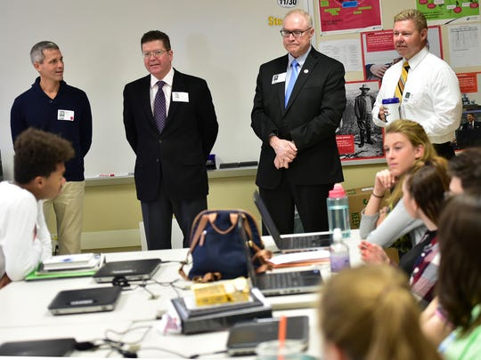 Government officials chat with students in teacher Josh Sherman's government class at CASHS on Wednesday, October 12, 2016. Standing from left, are, State Rep. Rob Kauffman, Franklin County Commissioners David Keller and Bob Thomas and State Sen., Rich Alloway.
