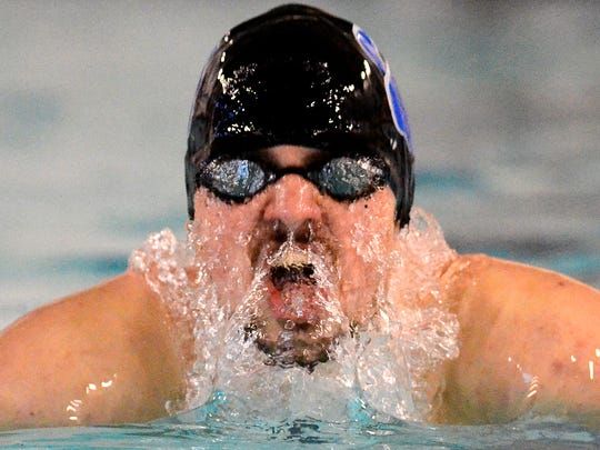 Dallastown's Logan Brockway swims the breaststroke leg of the 200 IM event against New Oxford, Thursday, Feb. 2, 2017. John A. Pavoncello photo