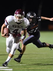 New Paltz's Jimmy Verney carries the ball as Marlboro's