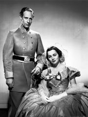 "Leslie Howard and Olivia de Havilland star in the 1939 motion picture ""Gone With the Wind."""