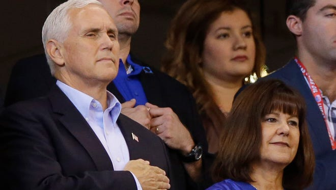Vice President Mike Pence and his wife, Karen, stand during the national anthem before the Indianapolis Colts-San Francisco 49ers game Sunday.