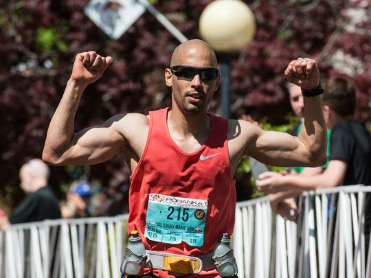 Vladimir Martinez-Jimenez celebrates after finishing the Inaugural Salisbury Marathon on Saturday, April 28, 2018.