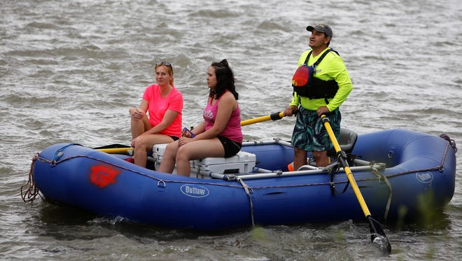 Saturday's Riverfest celebration was highlighted by rafting trips down the Animas River. The festival continues Sunday at Berg and Animas Parks in Farmington.