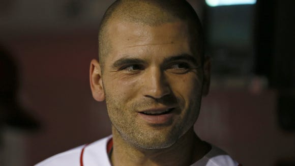 Reds first baseman Joey Votto smiles in the dugout during the bottom of the eighth inning Tuesday night.
